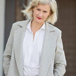 outdoor headshot of blonde